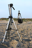 Camera tripod. S outdoor at a photographing session Stock Images