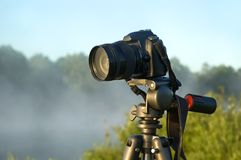 Camera on tripod Stock Images