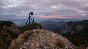 Camera on a tripod is capturing the sunrise in a beautiful mount Stock Photos