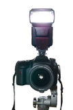 Camera on tripod with flash firing Royalty Free Stock Photography