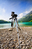 Camera with tripod on a lakeside Royalty Free Stock Photo