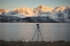 Camera and tripod in the Norwegian fjords Royalty Free Stock Images