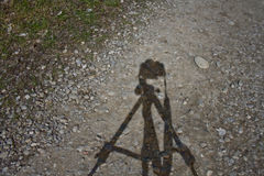 Camera on tripod shadow Stock Photo