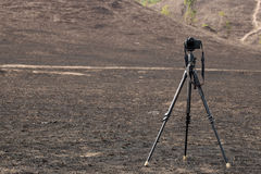 Camera on the tripod shooting on Burnt after a mountain fire Stock Image