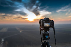 Camera on tripod. At sunset Stock Photography