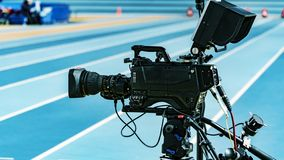 Camera, TV broadcast on olympic track royalty free stock images