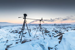 The camera on the two tripods during timelapse shooting. Arctic tundra, winter Stock Image
