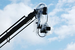Camera under cover on crane or jib Royalty Free Stock Image