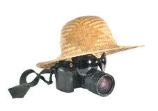 The camera under a hat. The camera with points under a hat lie on a table Royalty Free Stock Image