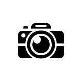 Camera vector icon. On grey background Royalty Free Stock Photography