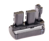 Camera vertical grip and batteries Royalty Free Stock Image