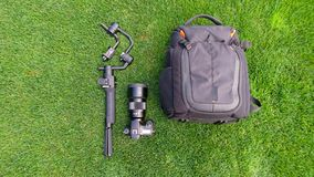 Camera and video production equipment on grass. stock photos
