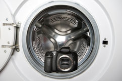 Camera in washing machine Stock Photos