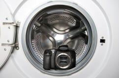 Camera in wasmachine stock foto's