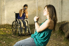 Camera and Wheelchair Royalty Free Stock Photos