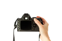 Camera in woman hand Stock Images