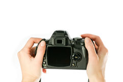 Camera in woman hands stock photography