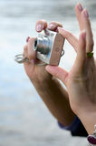 Camera in the women's hands. Royalty Free Stock Image