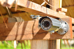 Camera on the wood wall Royalty Free Stock Photos