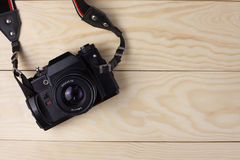 Camera on wooden background Stock Image