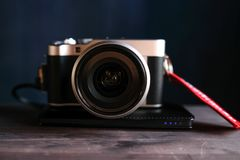 The camera is on a wooden table close-up royalty free stock photography