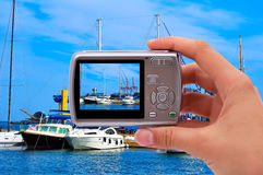 Camera and yachts Stock Photography