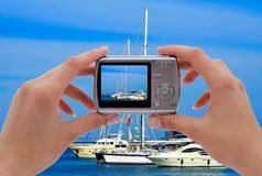 Camera and yachts Stock Photos
