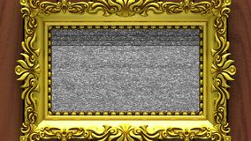 Camera zoom into the gold picture frame on background of brown wood. Tv noise and green chroma key plays on the screen. Camera zoom into the gold picture frame stock footage