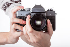 Camera zooming. A person holding a camera in their hands and zooming Royalty Free Stock Photography