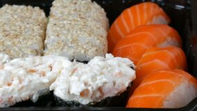 Camera zooms stylish fresh sushi set with various kinds of sushi rolls, close up. View stock video footage