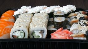 Camera zooms stylish fresh sushi set with various kinds of sushi rolls, close up. View stock footage