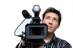 Cameraman. With a professional camera on a white background stock photos