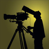 Cameraman. Silhouette of a cameraman on a yellow background - vector illustration Stock Photography