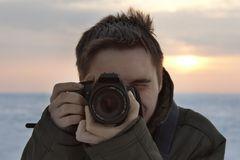 Cameraman. Professional photographer with dSLR while working Royalty Free Stock Images