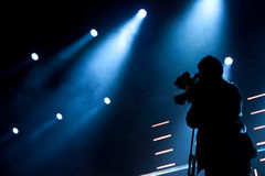 Cameraman. Silhouette on a concert stage Stock Photography
