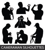 Cameraman. Silhouettes of people taking pictures Stock Image