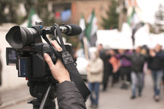 Cameraman. Covering an event with a video camera Royalty Free Stock Image