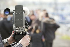 Cameraman. Covering an event with a video camera Royalty Free Stock Photo