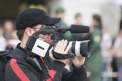 The cameraman. With videocamera on work Stock Photo