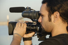 Cameraman. Filming Footage On Location stock photo