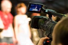 Cameraman. With digital video camera Stock Images