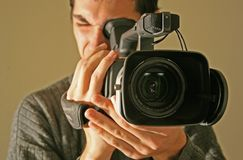 Cameraman. Man filming with modern camera Royalty Free Stock Photo
