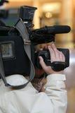 Cameraman. TV cameraman in action royalty free stock image