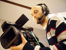 Cameraman. An image with a television cameraman working with camera Royalty Free Stock Image