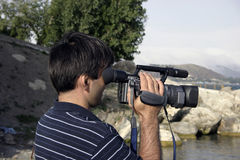 Cameraman. Operator at work royalty free stock photo