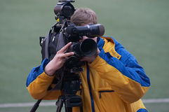 Cameraman. Video operator by the football match Royalty Free Stock Photos