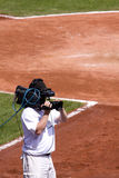 Cameraman on Baseball Field. Television Cameraman video taping a baseball game Royalty Free Stock Image
