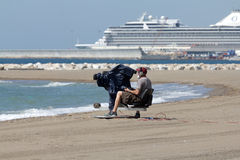 Cameraman at the beach Royalty Free Stock Image