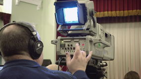 Cameraman with a big TV broadcast camera stock footage