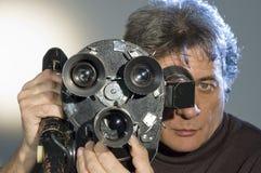 Cameraman  and camera. Royalty Free Stock Photo